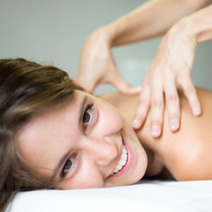 smiling Female getting massage